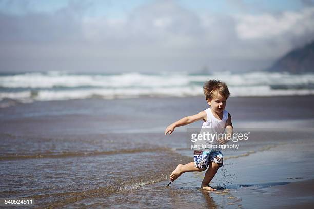 Boy running by the ocean
