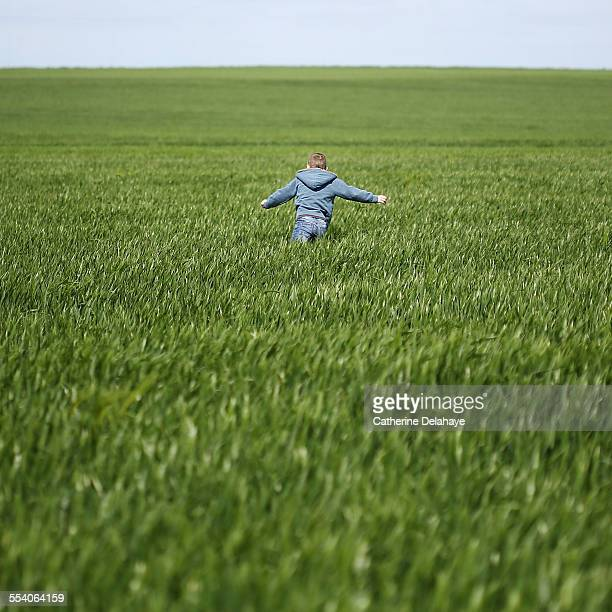 A boy running in a field