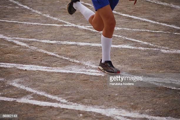 Boy running in school sports race