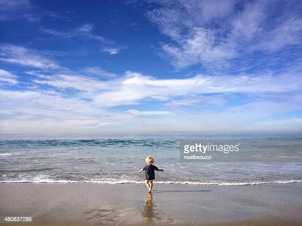 USA, California, Toddler (18-32 months) running at beach