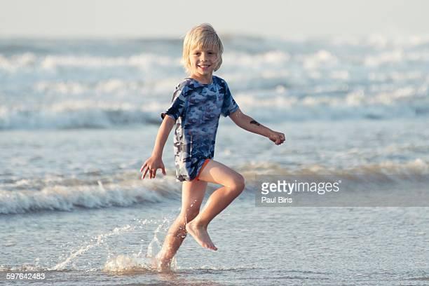 Boy running on beach, Baltic sea , Denmark