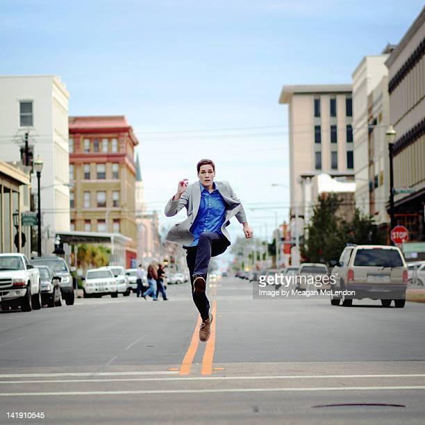 Boy running on highway