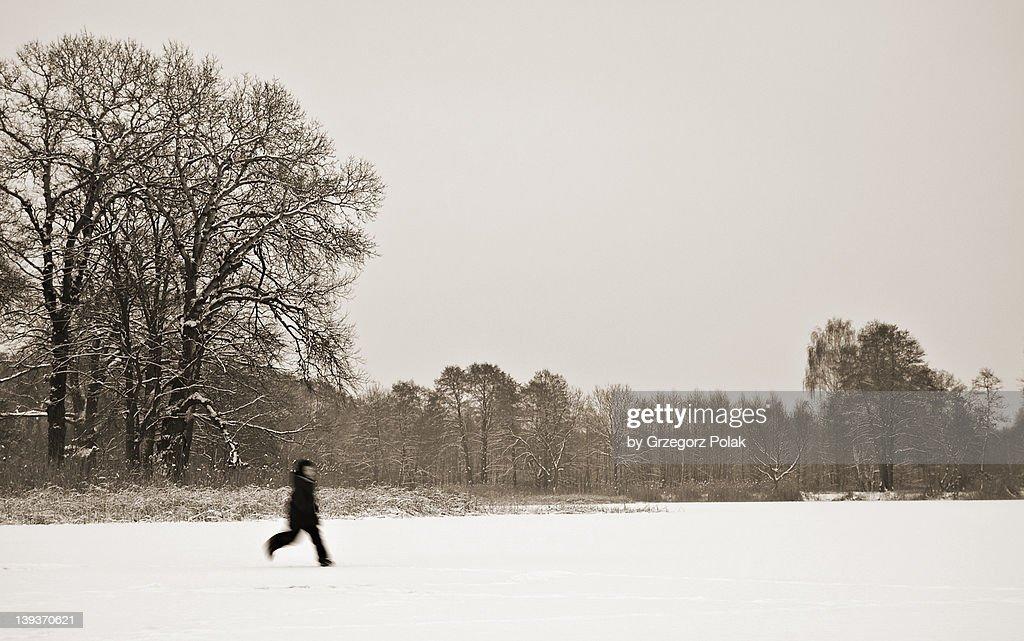 Boy running on thin ice : Stock Photo