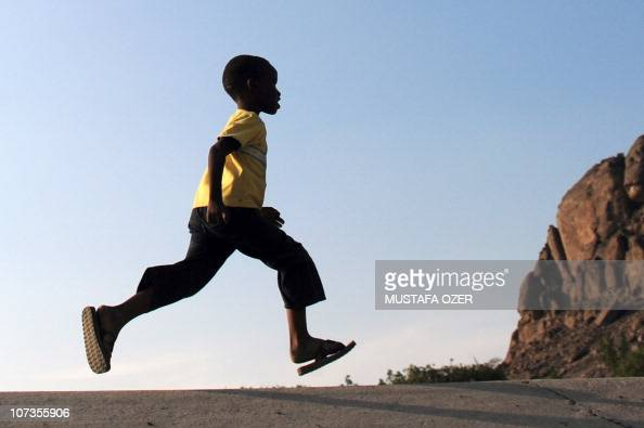 A boy runs across the road in Mina five kilometres east of the Saudi Arabian holy city of Mecca on November 14 as some 25 million Muslim pilgrims...