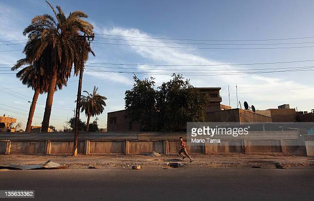 A boy runs down a street on December 12 2011 in Baghdad Iraq Iraq is transitioning nearly nine years after the 2003 US invasion and subsequent...