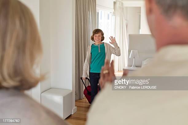 Boy saying goodbye to his grandparents