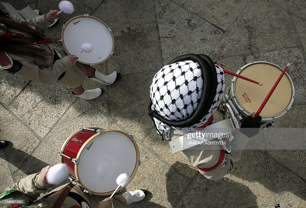 A boy scout drummer marches during Christmas eve celebrations in Manger Square outside the Church of the Nativity, believed to be the birthplace of Jesus Christ, in the Biblical West Bank town of Bethlehem, on December 24, 2012. AFP PHOTO/JAAFAR ASHTIYEH