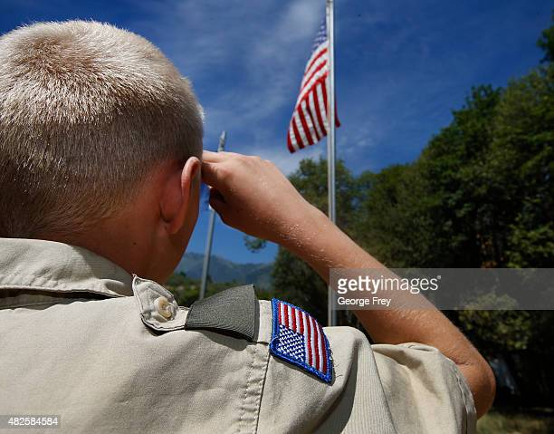Boy Scout salutes the American flag at camp Maple Dell on July 31 2015 outside Payson Utah The Mormon Church is considering pulling out of its 102...