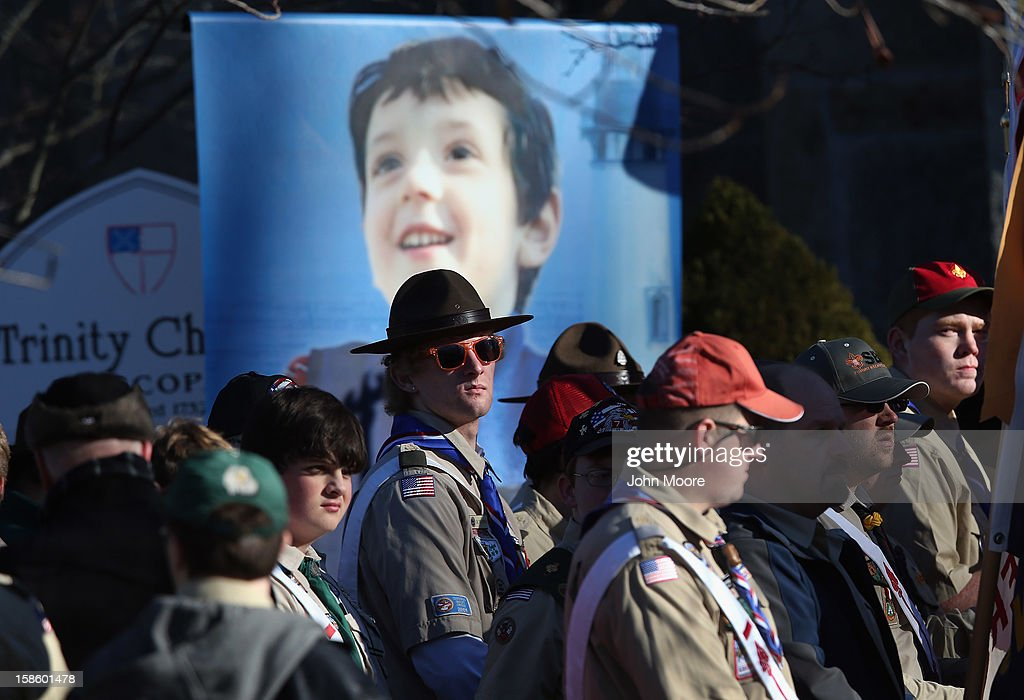 Boy scouts await a funeral procession for Benjamin Wheeler, 6, (in photo), at the Trinity Episcopal Church on December 20, 2012 in Newtown, Connecticut. Benjamin, a member of Tiger Scout Den 6, was killed when 20 children and six adults were massacred at Sandy Hook Elementary School last Friday.