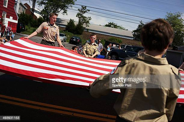 Boy Scouts carry an American Flag in the annual Memorial Day Parade on May 26 2014 in Fairfield Connecticut Across America towns and cities will be...