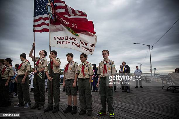 Boy Scouts of Troop 37 Staten Island prepare to lead a march of Staten Island residents to mark the two year anniversary of Superstorm Sandy's...