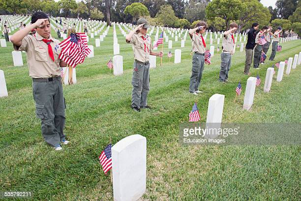 Boy scouts saluting at US Flags at 2014 Memorial Day Event Los Angeles National Cemetery California