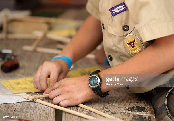 Boy Scouts work on a wood project at camp Maple Dell on July 31 2015 outside Payson Utah The Mormon Church is considering pulling out of its 102 year...