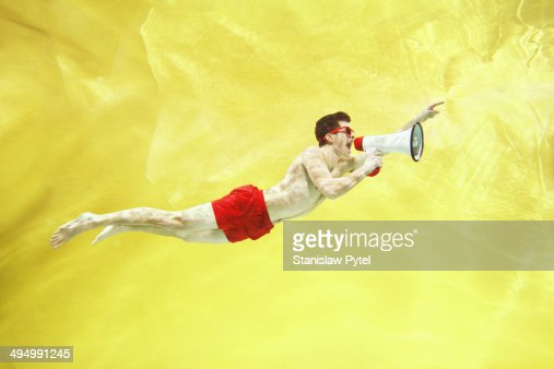 Boy screaming underwater with megaphone : Stock Photo