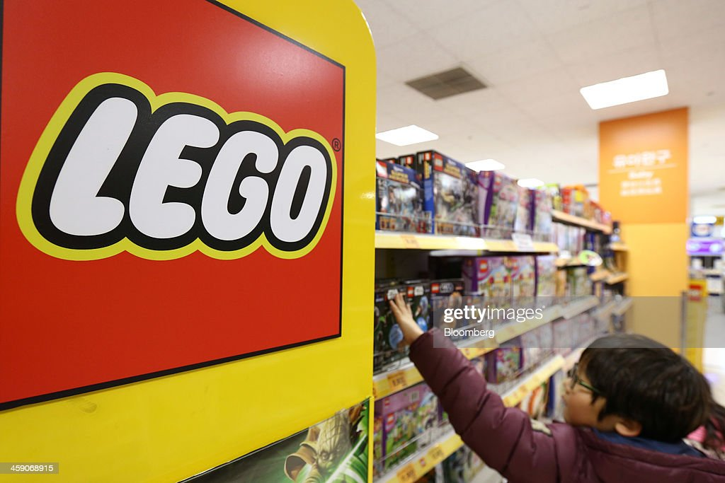 A boy selects a boxed Lego A/S toy at an E-Mart Co. store, a subsidiary of Shinsegae Co., in Incheon, South Korea, on Saturday, Dec. 21, 2013. Consumer prices climbed 0.9 percent in November from a year earlier after a 0.7 percent increase in October that was the smallest gain since July 1999. Photographer: SeongJoon Cho/Bloomberg via Getty Images
