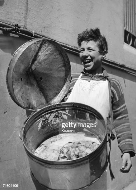 A boy selling pizza from a bin slung round his neck Naples circa 1960