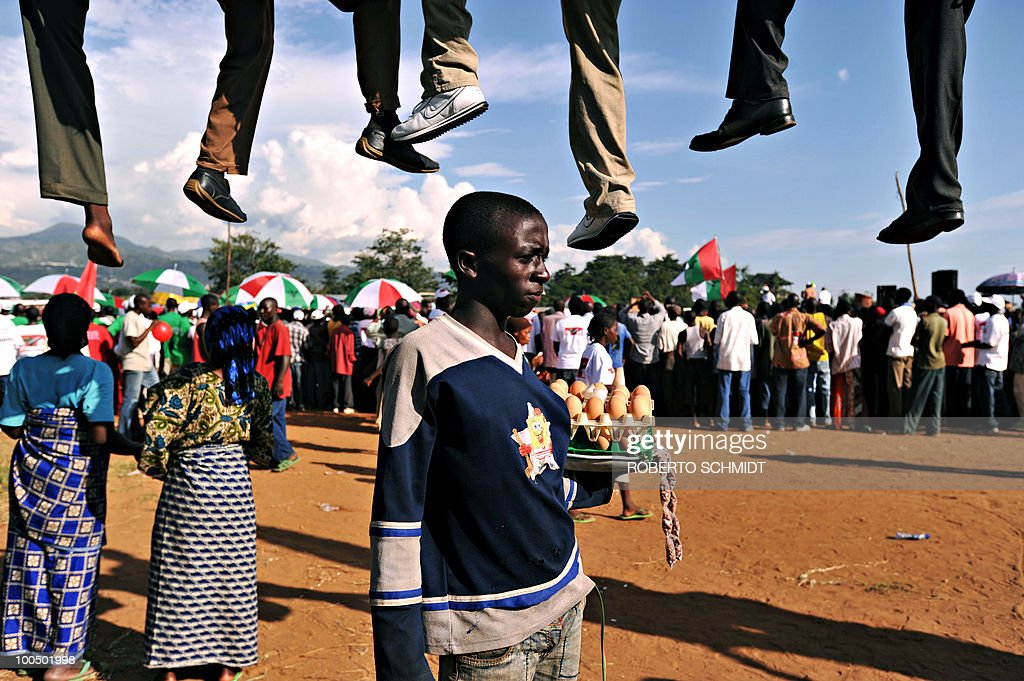 A boy sells eggs during a political rally for the ruling party at a sports field in Bujumbura on May 11, 2010. Some 3.5 million registered voters will go to the polls to elect 1,935 municipal counselors across the country on May 20th in what experts agree will be a catlyst for the soon to follow Legislative and Presidential elections. This elections will be the fist all inclusive elections since a peace accord ended a bloody 13 year civil war in 2006. The French government has provided Burundi with 90,000 euros to organize the upcomming elections.