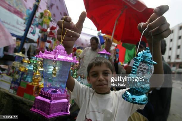 A boy sells lanterns in the popular Alzaoya market in preparation for the Muslim holy month of Ramadan on September 01 2008 in Gaza City Gaza Ramadan...