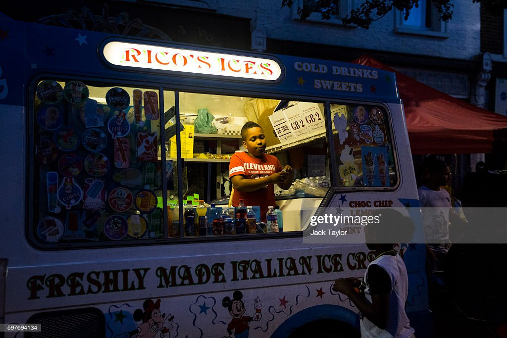 A boy serves ice cream at the Notting Hill Carnival on August 29 2016 in London England The Notting Hill Carnival which has taken place annually...