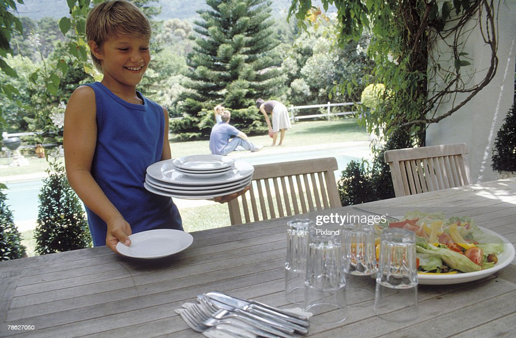Boy setting table  sc 1 st  Thinkstock & Boy Setting Table Stock Photo | Thinkstock