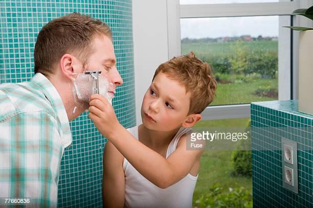 Boy Shaving Father