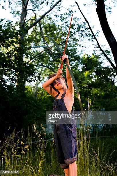 Boy shooting a bow and arrow