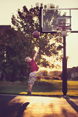 Boy shooting a layup