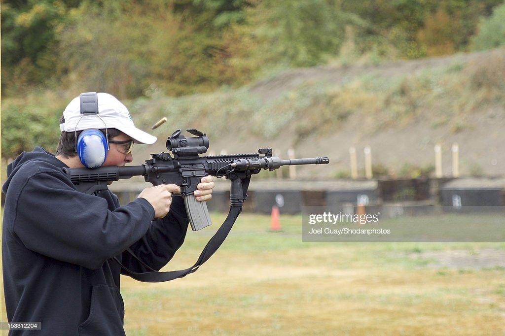 Boy shooting rifle