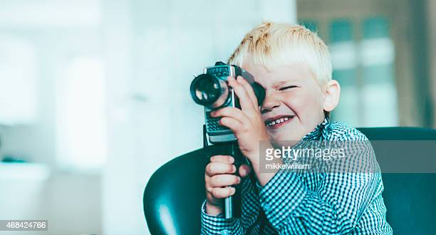 Boy shoots a video with an old video camera