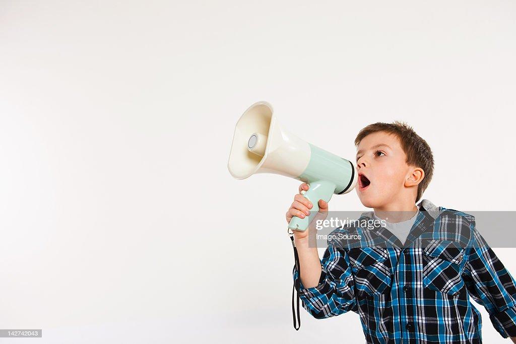Boy shouting through megaphone