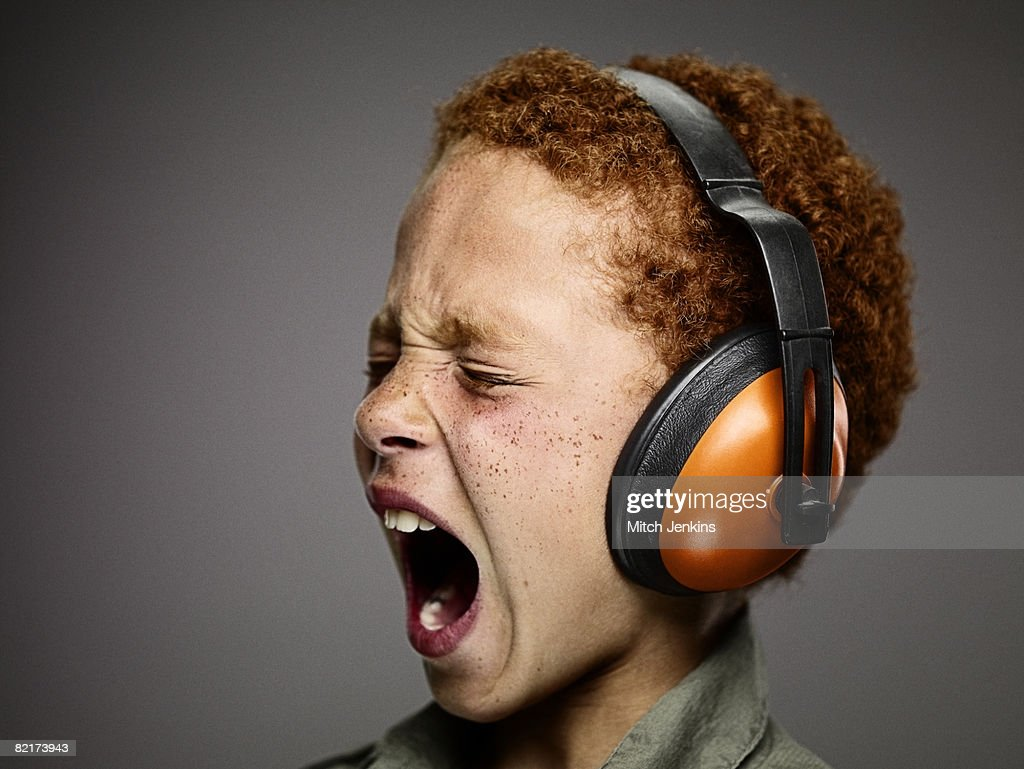 Boy Shouting With Ear Defenders : Stock Photo