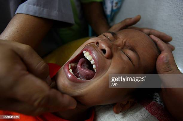 A boy shouts as he under goes circumcision during ceremony in Kajang outside Kuala Lumpur on November 20 2011 About 30 boys aged between 7 and 11 who...