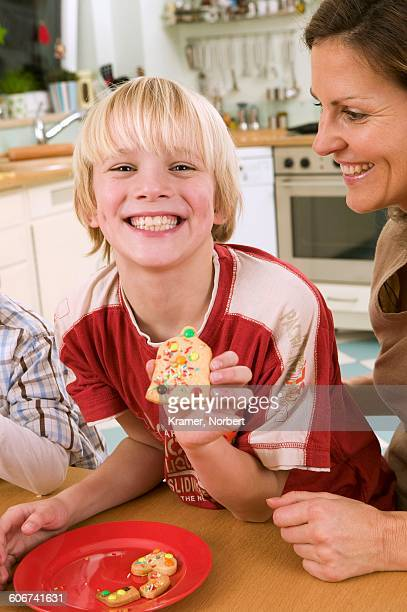 Boy showing a biscuit he made himself