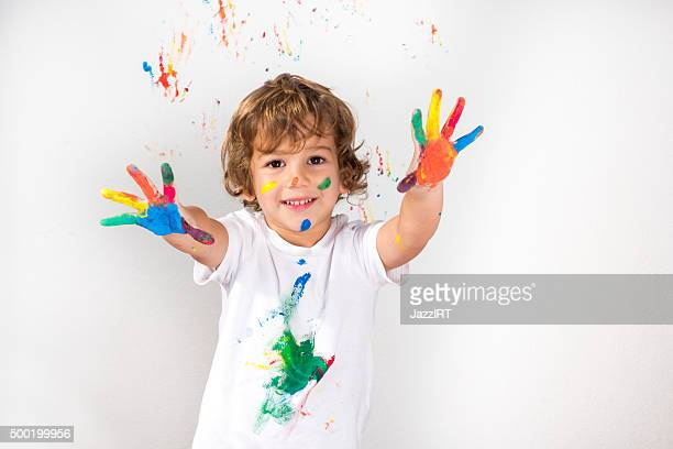 Boy Showing Colorful Paint on His Hands