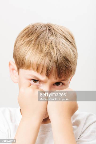 Boy Showing Fist Over White Background