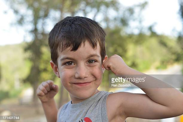 Boy showing his muscles