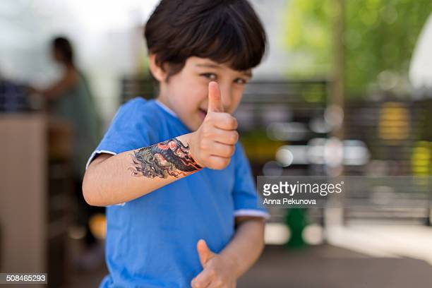 Boy showing off his dragon tatoo