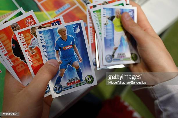 A boy shows his game cards during the German championship match of the 'Topps Match Attax Trading Card Game' prior to the Bundesliga match between...