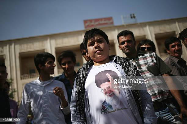 A boy shows off his tshirt with the visage of Iran's supreme leader Ayatollah Ali Khamenei outside the shrine to the Ayatollah Khomeini on the 25th...