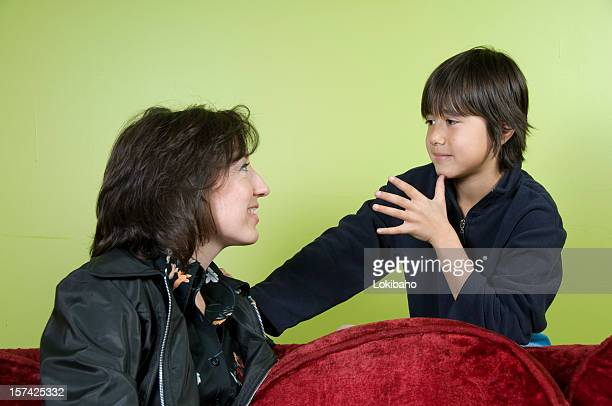Boy signing Mom in ASL