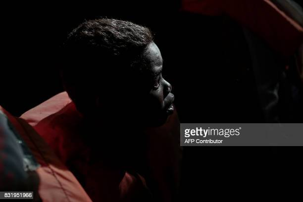A boy sits aboard a boat of run by of Aquarius rescue ship run by NGO SOS Mediterranee and Medecins Sans Frontieres after he was rescued by NGO...