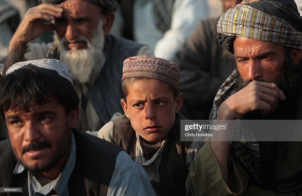 A boy sits among Afghan Pashtun tribal elders during a traditional meeting to discuss American and Canadian military actions on their lands October 26, 2009 in the village of Hazi Madad in the Kandahar province of Afghanistan. American and Canadian troops in the area have been trading blows with Taliban militant fighters in recent battles, but local tribal chiefs complain that civilians have been caught in the crossfire.