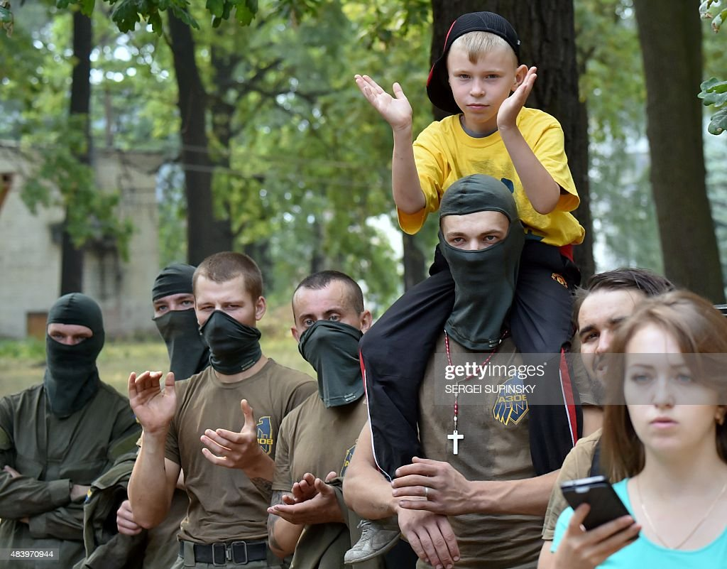 azov boy A boy sits on the shoulders of a relative, one of several recruits to the  Azov far-right Ukrainian volunteer battalion, as they watch a competition  in Kiev, ...
