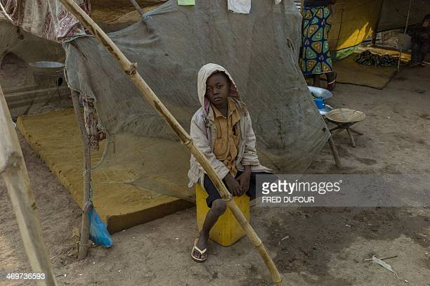 A boy sits while posing in Bangui Central African Republic on February 16 2014 Troops from several EU countries will begin deploying in the...
