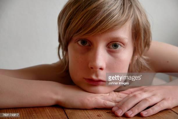 Boy sitting a a table
