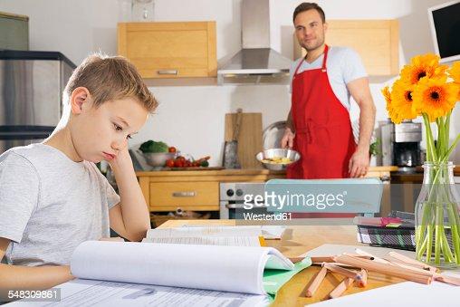 Young boy concentrating on his homework and asks his father for help   HD  stock video Shutterstock
