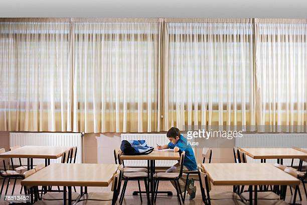 Boy Sitting at School Desk