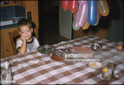 Boy sitting by table : Stock Photo