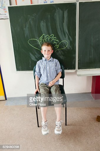 Boy sitting in classroom : Stock-Foto