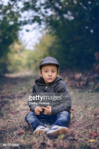 Boy sitting in forest
